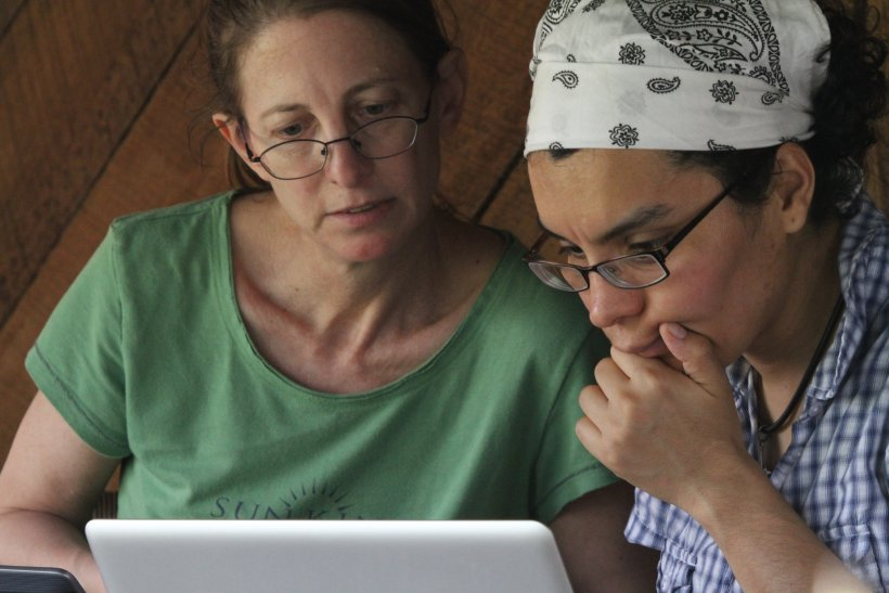 Betsy Dumont and Liliana Davalos pondering the data