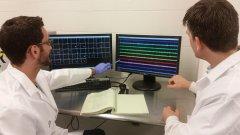 David Moorman, right, and graduate student John Hernandez in the neuroscience and behavior program lab at UMass Amherst.
